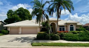 Front View of White Tile Roof by Zoller Roofing Deer Creek in Sarasota FL