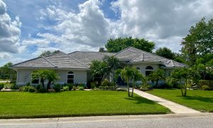 Front View of Gray Flat Tile Roof by Zoller Roofing in Sarasota FL