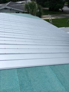 Panel Installation of Metal Roof by Zoller Roofing in Sarasota FL