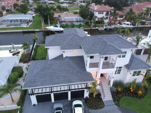 Aerial View of Gray Flat Tile Roof by Zoller Roofing in Sarasota FL