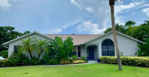 Front View of Light Brown Shingle Roof by Zoller Roofing in Sarasota FL