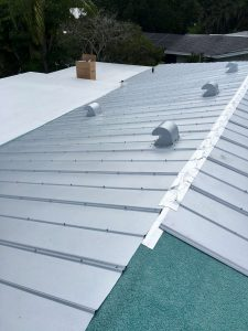 Putting on Metal Panels During Metal Roof Installation by Zoller Roofing in Sarasota FL
