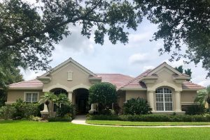 Front View of Multi-Colored Blend Flat Tile Roof by Zoller Roofing in Sarasota Fl