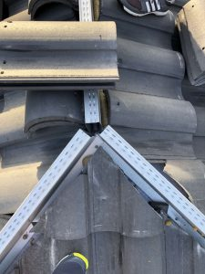 Metal Ridge Channel Supporting Hip and Ridge Tiles, Zoller Roofing, Sarasota FL
