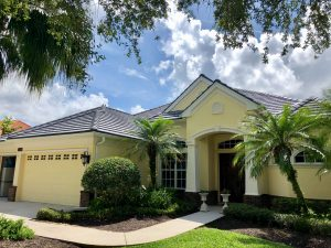 Front View of Dark Gray Flat Tile Roof by Zoller Roofing in Sarasota FL